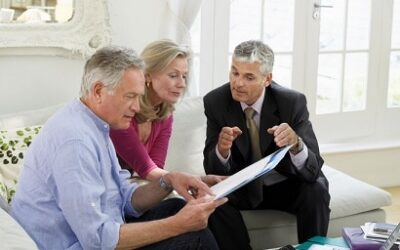 Ed Rempel helping clients with their retirement plan